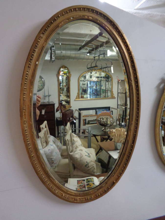 Antique Gold Gilt Bevelled Oval Mirror.